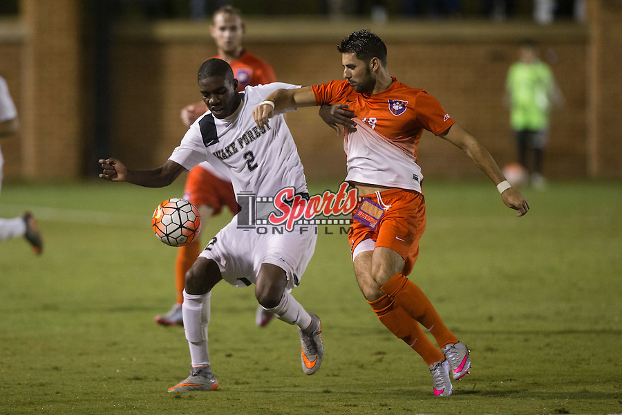 Kris Reaves (2) of the Wake Forest Demon Deacons battles for the ball with Kyle Murphy (19) of the Clemson Tigers at Spry Soccer Stadium on September 26, 2015 in Winston-Salem, North Carolina.  The Demon Deacons and the Tigers played to a 1-1 draw.  (Brian Westerholt/Sports On Film)