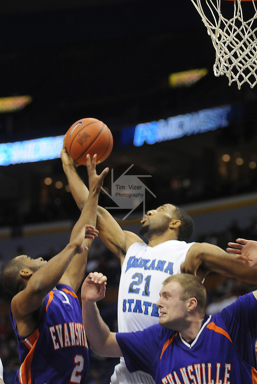 March 4,  2011         From left, Evansville Aces guard Kavon Lacey (2), Indiana State Sycamores forward/center Isiah Martin (21), and Evansville Aces center Pieter van Tongeren (41) under the basket trying for a rebound.  Indiana State played Evansville in the fourth quarterfinal game of the NCAA Missouri Valley Conference Men's Basketball Tournament on Friday March 4, 2011 at the Scottrade Center in downtown St. Louis.