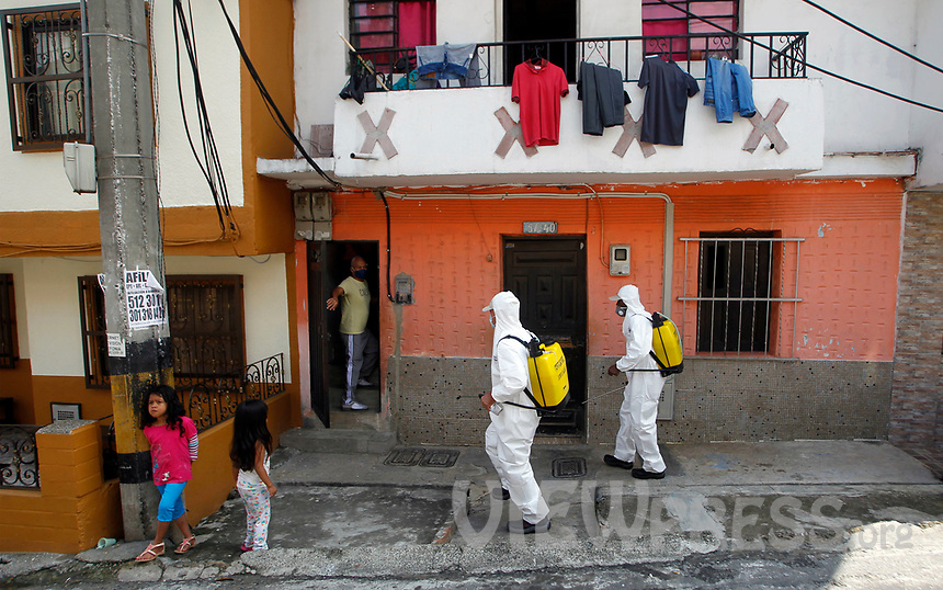 MEDELLIN, COLOMBIA-MAY 29: Two police officers with protective clothing disinfects the sidewalks and streets, in the Santa Cruz neighborhood in Medellín, Colombia, on May 29, 2020. The mayor of Medellín and the private company offer a mask facial, antibacterial gel and alcohol for city communes As a preventive measure against the new coronavirus COVID-19. (Photo by Fredy Builes / VIEWpress via Getty Images)