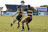 Gregor Christie chips the ball past Sepu Taufa. Counties Manukau Premier Club Rugby game between Bombay and Pukekohe, played at Bombay on Saturday June 30th 2018.<br /> Bombay won the game 24 - 14 after leading 24 - 0 at halftime.<br /> Bombay 24 - Sepuloni Taufa, Tulele Masoe, Chay Mackwood, Liam Daniela tries, Ki Anufe 2 conversions.<br /> Pukekohe Mitre 10 Mega 14 - Joshua Baverstock, Gregor Christie tries; Cody White 2 conversions.<br /> Photo by Richard Spranger.