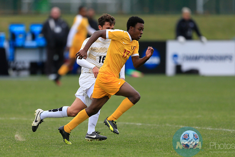 KANSAS CITY, MO - DECEMBER 03:  Tam Dimairo (17) of the University of Charleston and David Fairgrieve (16) of Wingate University battle for the ball during the Division II Men's Soccer Championship held at Children's Mercy Victory Field at Swope Soccer Village on December 03, 2016 in Kansas City, Missouri. Wingate beat Charleston 2-0 to win the National Championship. (Photo by Jack Dempsey/NCAA Photos via Getty Images)