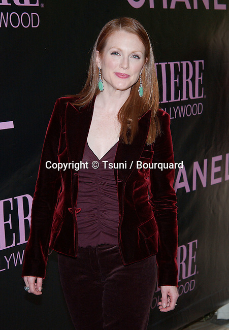 Julianne Moore arriving at the 9th Annual Premiere Women in Hollywood Luncheon at the Four Seasons Hotel in Los Angeles. October 16, 2002.           -            MooreJulianne244.jpg