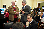 Congressman-elect Jim Bridenstine, right, from Oklahoma's First District, center, makes decisions about his future office, with his chief of staff Joe Kaufman, left, in the Rayburn House Office Building in Washington, DC on Nov. 30, 2012.