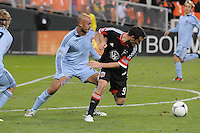 D.C. United forward Hamid Salihi (9) goes against Sporting Kansas City defender Aurelien Collin (78) Sporting Kansas City defeated D.C. United  1-0 at RFK Stadium, Saturday March 10, 2012.