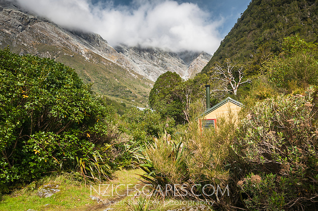 Top Butler Hut in Whataroa Valley with Southern Alps in background, South Westland, West Coast, New Zealand