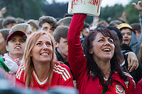 Wales fans at the Cardiff Fanzone during the Euro 2016 quarter final between Wales and Belgium , Cardiff, Wales on 1 July 2016. Photo by Mark  Hawkins/PRiME Media Images.