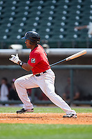 Marcus Lemon (2) of the Birmingham Barons follows through on his swing against the Tennessee Smokies at Regions Field on May 4, 2015 in Birmingham, Alabama.  The Barons defeated the Smokies 4-3 in 13 innings. (Brian Westerholt/Four Seam Images)