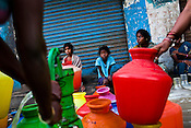 Local residents fill up water buckets at the water pump in early hours of the day in Korukkupet slum in Chennai, Tamil Nadu, India.  Photo by Sanjit Das/Panos