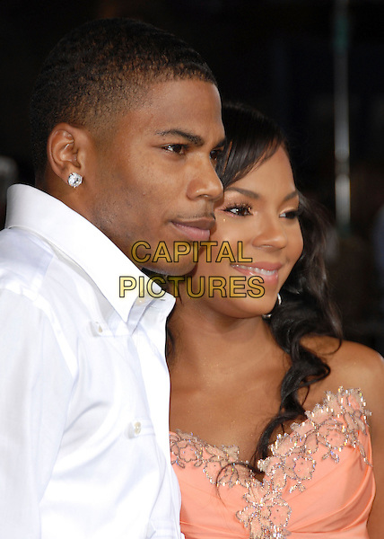 """NELLY & ASHANTI.Los Angeles Premiere of """"John Tucker Must Die"""" held at The Grauman's Chinese Theatre in Hollywood, California  .July 25th, 2006.Ref: DVS.headshot portrait strapless profile.www.capitalpictures.com.sales@capitalpictures.com.©Debbie VanStory/Capital Pictures"""