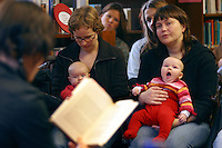 "Three month old Jenny struggles to stay awake as her mother Marit Helland listens to a book reading. An activity aimed at the parents rather than the babies, libraries invite authors to read on special ""book 'n' baby"" days..In contrast to most European countries, the Norwegian birth rate is a healthy 1.9. Norway's reputation as a child friendly society is partially founded on a succession of government initiatives to improve parents' rights and economic circumstances."