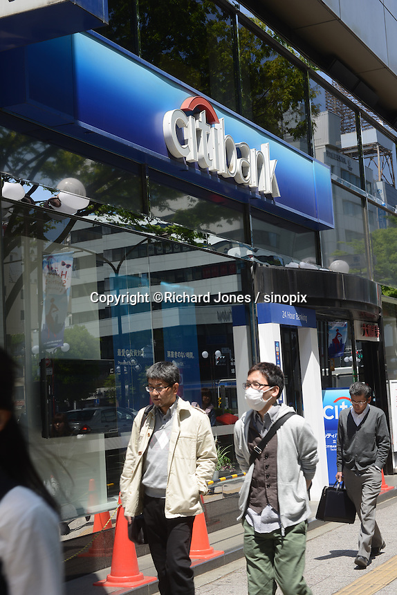 People are passing in front of American mega bank, Citibank in Tachikawa, Tokyo, Japan.