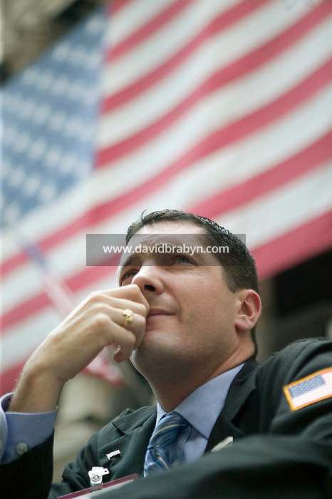 31 August 2005 - New York City, NY - A trader takes a break outside the New York Stock Exchange on Broad street in New York City, USA, 31 August 2005. Photo Credit: David Brabyn