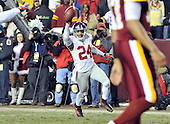 Landover, MD - December 21, 2009 -- New York Giants cornerback Terrell Thomas (24) celebrates as he returns a third quarter interception for a touchdown against the Washington Redskins at FedEx Field in Landover, Maryland on Monday, December 21, 2009.  The Giants won the game 45 - 12..Credit: Ron Sachs / CNP.(RESTRICTION: NO New York or New Jersey Newspapers or newspapers within a 75 mile radius of New York City)