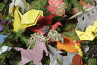 OrigamiUSA artists preparing the models and designing the Holiday Tree at the American Museum of Natural History. Detail of the tree.