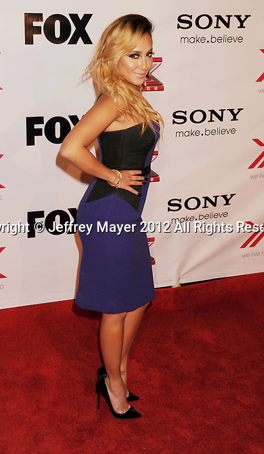 LOS ANGELES, CA - DECEMBER 06: Adrienne Bailon arrives at the 'The X Factor' Viewing Party Sponsored By Sony X Headphones at Mixology101 & Planet Dailies on December 6, 2012 in Los Angeles, California.