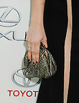BURBANK, CA- OCTOBER 18: Actress Francesca Eastwood (handbag, ring detail) at the 2014 Environmental Media Awards at Warner Bros. Studios on October 18, 2014 in Burbank, California.