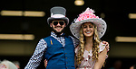 LOUISVILLE, KY - MAY 04: A couple poses for a phot dressed in their Oaks day best on Kentucky Oaks Day at Churchill Downs on May 4, 2018 in Louisville, Kentucky. (Photo by Eric Patterson/Eclipse Sportswire/Getty Images)