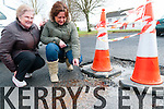 Tarbert Water Leak: Patricia Mcnamara & Anna McGibney, Tieraclea Park, Tarbert pointing to where the water is leaking and flowing into a man hole.