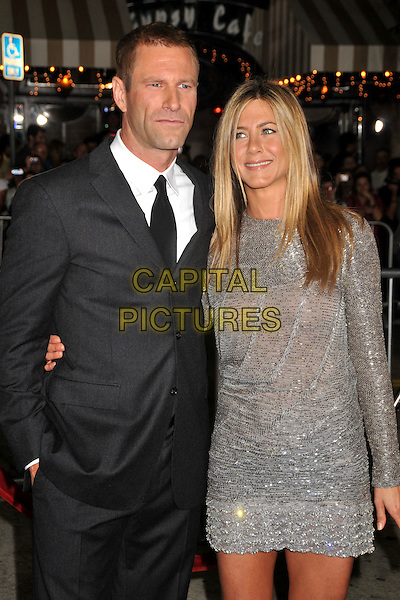 "AARON ECKHART & JENNIFER ANISTON.""Love Happens"" Los Angeles Premiere held at Mann's Village Theatre, Westwood, California, USA..September 15th, 2009.half length grey grey black suit jacket  silver sparkly long sleeved sleeved beaded beads dress mini nipples sheer see through thru .CAP/ADM/BP.©Byron Purvis/AdMedia/Capital Pictures."