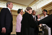 "US President George W. Bush, with Secretary Rice's Aunt Genoa ""Gee""McPhatter(2L) and Uncle Alto Ray(2R), looks on as Secretary of State Condoleezza Rice takes the Oath of Office from Supreme Court Justice Ruth Bader Ginsberg(C) during a swearing in ceremony in the Benjamin Franklin Room of the Department of State in Washington, DC Friday 28 January 2005. Secretary Rice, who is the second woman and the first black woman to become Secretary of State, was sworn in by White House chief of staff Andrew Card Wednesday evening, hours after the Senate confirmed her by a vote of 85 to 13,  in a private ceremony at the White House.<br /> Credit: Shawn Thew / Pool via CNP"