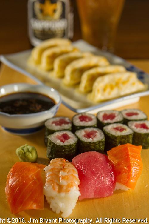 Japanese Sushi Nigiri,Tekka Maki Tuna Rolls and Gyoza with Sapporo Beer. ©2016.  Jim Bryant Photo. All Rights Reserved.