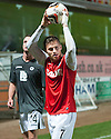 Dundee Utd's David Goodwillie claims the match ball after scoring a hat trick.
