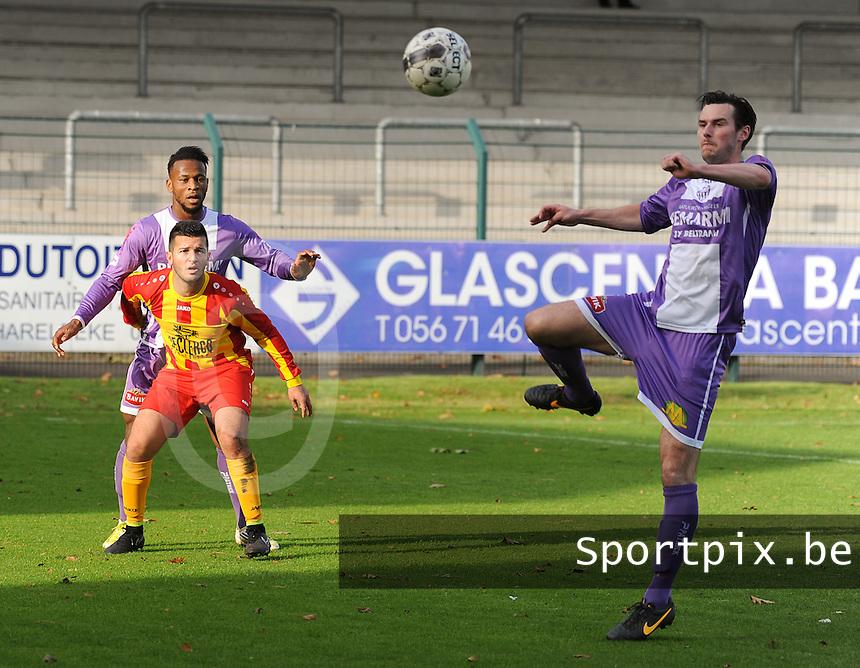 Harelbeke - RC Waregem :<br /> <br /> Jens Noppe (R) onderschept de bal voor de ogen van Vinny Mayele Mansengina (L) en Nasredinne Hariti (M)<br /> <br /> foto VDB / BART VANDENBROUCKE