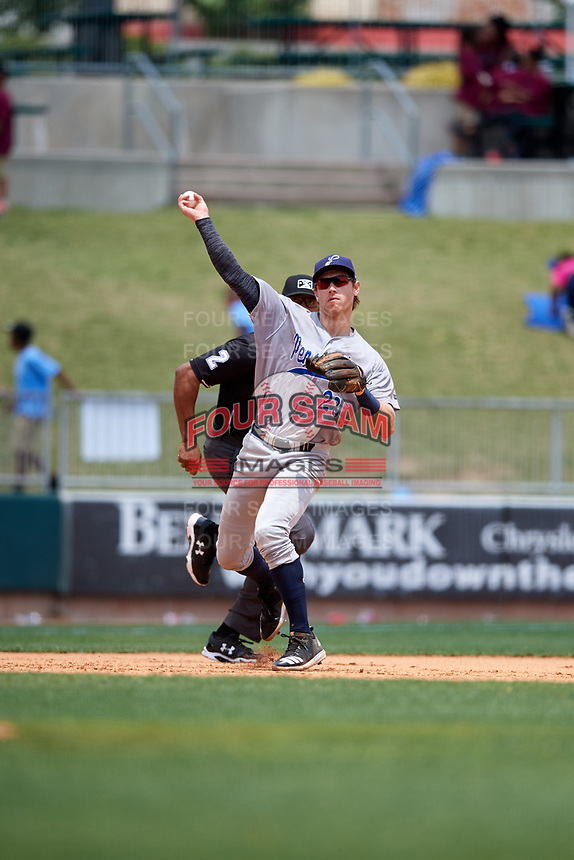 Pensacola Blue Wahoos third baseman Taylor Sparks (23) throws to first base in front of third base umpire Jose Navas during a game against the Birmingham Barons on May 9, 2018 at Regions Field in Birmingham, Alabama.  Birmingham defeated Pensacola 16-3.  (Mike Janes/Four Seam Images)