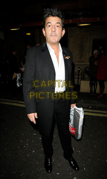 "JOHN ALTMAN .Attending the ""Born Free - Wild and Live'"" Charity Gala at the Royal Albert Hall, London, England, UK, .November 14th 2009..full length black suit white shirt long jacket bag .CAP/CAN.©Can Nguyen/Capital Pictures"