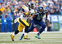 DeAngelo Williams #34 of the Pittsburgh Steelers runs with the ball in front of Bobby Wagner #54 of the Seattle Seahawks in the first half during the game at CenturyLink Field on November 29, 2015 in Seattle, Washington. (Photo by Jared Wickerham/DKPittsburghSports)