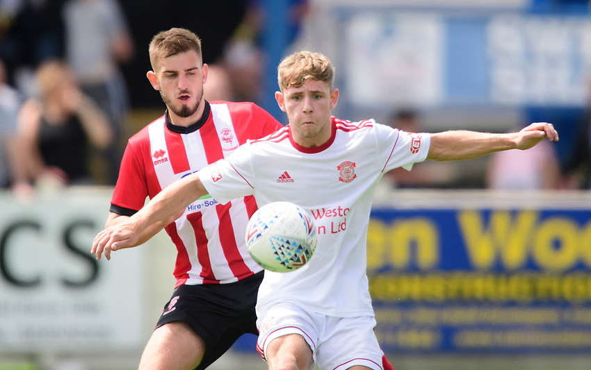 Lincoln United's trialist shields the ball from Lincoln City's trialist<br /> <br /> Photographer Chris Vaughan/CameraSport<br /> <br /> Football Pre-Season Friendly (Community Festival of Lincolnshire) - Lincoln City v Lincoln United - Saturday 6th July 2019 - The Martin & Co Arena - Gainsborough<br /> <br /> World Copyright © 2018 CameraSport. All rights reserved. 43 Linden Ave. Countesthorpe. Leicester. England. LE8 5PG - Tel: +44 (0) 116 277 4147 - admin@camerasport.com - www.camerasport.com