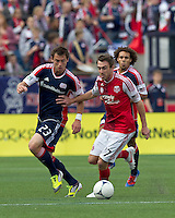 New England Revolution forward Blake Brettschneider (23) attempts to control the ball as Portland Timbers midfielder Eric Alexander (17) defends. In a Major League Soccer (MLS) match, the New England Revolution defeated Portland Timbers, 1-0, at Gillette Stadium on March 24, 2012