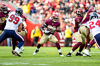 Landover, MD - November 18, 2018: Washington Redskins running back Adrian Peterson (26) runs the football during first half action of game between the Houston Texans and the Washington Redskins at FedEx Field in Landover, MD. (Photo by Phillip Peters/Media Images International)