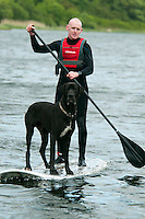 Galway, Ireland, June 2011.  A man takes his dog for a ride while stand up paddle boarding ( SUP ). Sea Kayaking along the Galway coast of west Ireland takes us to Connamara, Slyne Head, Streamstown, Ballinakill harbour, Cladaghduff, Old Head Campsite near westport and clew bay.  Photo by Frits Meyst/Adventure4ever.com