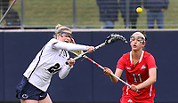Penn State's  Madison Carter (24) scores her fourth goal against Ohio State's Meg Camden (11) on April 1, 2017. Carter scored six goals in No. 6 Nittany Lions' 16-12 win over the Buckeyes.  Photo/©2017 Craig Houtz
