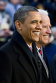 United States President Barack Obama, left, and Vice President Joe Biden arrive on the field at the 112th Army-Navy Football game at FedEx Field in Landover, Maryland on Saturday, December 10, 2011. .Credit: Kristoffer Tripplaar  / Pool via CNP