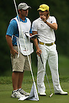 7 September 2008:    Camilo Villegas of Medellin, Colombia, South America shows his caddy Gary Mathews how close the ball was to going in on his putt on the ninth hole in the delayed third round of play at the BMW Golf Championship at Bellerive Country Club in Town & Country, Missouri, a suburb of St. Louis, Missouri on Sunday September 7, 2008. He and 23 other golfers had to finish their third round of competition Sunday morning before the fourth and final round could be played due to the suspension of third round play because of darkness on Saturday Sept. 6.  The BMW Championship is the third event of the PGA's  Fed Ex Cup Tour.