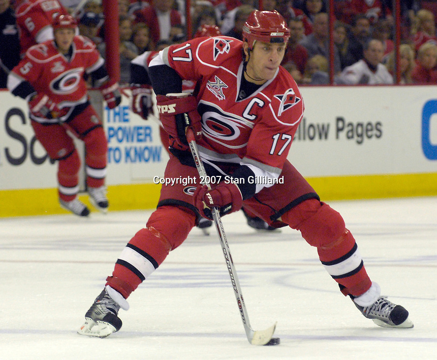 Carolina Hurricanes' Rod Brind'Amour brings the puck up ice against the Vancouver Canucks during their game Monday, Oct. 22, 2007 in Raleigh, NC. The Hurricanes won 3-1.