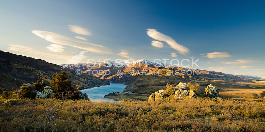 Panoramic of lenticular clouds, Leaning Rock and Lake Dunstan from the Clyde Lookout at sunset, Central Otago, New Zealand