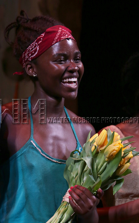 Lupita Nyong'o onstage during the 'Eclipsed' broadway opening night curtain call at The Golden Theatre on March 6, 2016 in New York City.