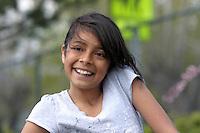 Portrait of a happy young hispanic girl