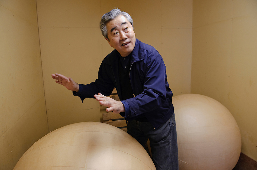 "CEO Masanori Honda with two ""yonshakudama"" 420kg fireworks made by Katakai Fireworks Co., Ltd, Katakai, Japan, April 6, 2009. The company makes the world's largest firework, a 120cm round shell called a ""yonshakudama""."