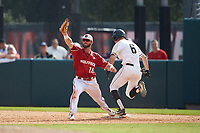 North Carolina State Wolfpack first baseman Evan Edwards (18) stretches for a throw as Trey Martin (6) of the Army Black Knights lunges for the base at Doak Field at Dail Park on June 3, 2018 in Raleigh, North Carolina. The Wolfpack defeated the Black Knights 11-1. (Brian Westerholt/Four Seam Images)