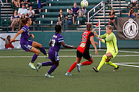 Rochester, NY - Saturday June 11, 2016: Orlando Pride forward Alex Morgan (13) attempts to chip a shot over Western New York Flash goalkeeper Britt Eckerstrom (28) during a regular season National Women's Soccer League (NWSL) match between the Western New York Flash and the Orlando Pride at Rochester Rhinos Stadium.