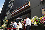 Customers wait outside the new Honey Baked Ham store in Tokyo, Japan on August 6, 2015. The Honey Baked Ham Company LLC in collaboration with Toranomon Ham Co., Ltd., opened its first international store in downtown Tokyo. The company with more than 400 locations in the USA is expanding its operations overseas for first time in its 55-year history. (Photo by Rodrigo Reyes Marin/AFLO)