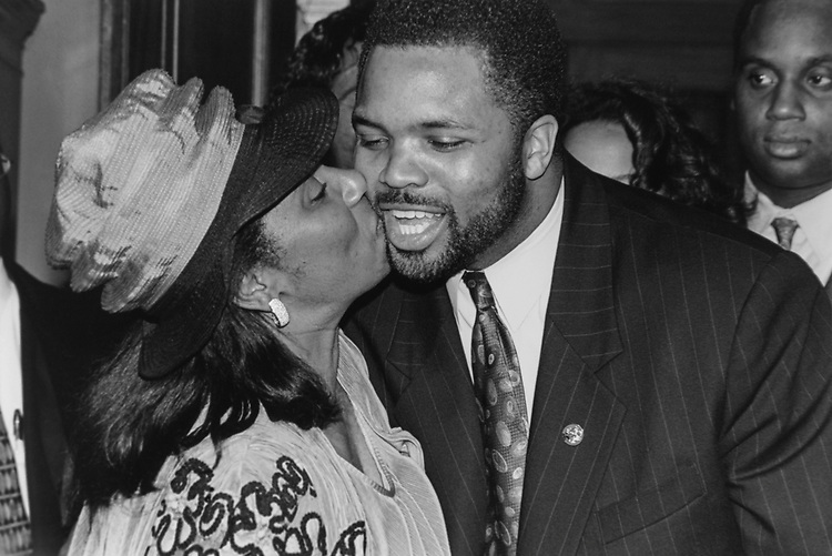 Rep. Jesse Jackson, D-Ill., receives a congrats kiss from his mother, Jacqueline, after his swearing-in ceremony on Dec. 18, 1995. (Photo by Laura Patterson/CQ Roll Call via Getty Images)