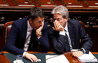 Il Presidente del Consiglio Matteo Renzi ascolta il Ministro degli Esteri Paolo Gentiloni, a destra, dopo aver parlato alla Camera dei Deputati in vista del prossimo Consiglio Europeo, a Roma, 16 dicembre 2014.<br /> Italian Premier Matteo Renzi, listens to Foreign Minister Paolo Gentiloni, right, after speaking at the Lower Chamber ahead of the upcoming European Council, in Rome, 16 December 2014.<br /> UPDATE IMAGES PRESS/Riccardo De Luca