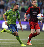 Seattle Sounders Clint Dempsey (2) moves the ball against  Portland Timbers Nat Borchers (7)  during an MLS match on April 26, 2015 at CenturyLink Field in Seattle, Washington.  Seattle Sounders Clint Dempsey scored a goal to give the Sounders a 1-0 victory over the Timbers. Jim Bryant Photo. ©2015. All Rights Reserved.
