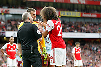 Referee, Jonathan Moss listens to Mattéo Guendouzi of Arsenal and Thomas Heaton of Aston Villa during the Premier League match between Arsenal and Aston Villa at the Emirates Stadium, London, England on 22 September 2019. Photo by Carlton Myrie / PRiME Media Images.