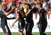 Chris Pontius (13) of D.C. United celebrates with teammaes his score.  D.C. United tied the Los Angeles Galaxy 2-2, at RFK Stadium, Saturday September 14 , 2013.